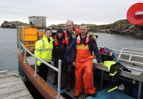 SSPCA auxiliary officer Terresa Leask, Jan and Pete Bevington from Hillswick Wildlife Sanctuary and Sean Williamson on board his creel boat Emeritus back at Bousta after rescuing the seal.