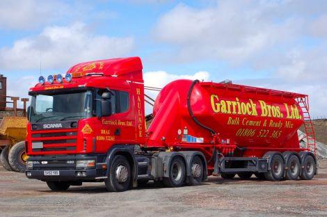One of Garriock Bros.' fleet of bright red lorries and trucks - Photo: Garriock Bros.