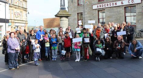 Scores of people turned up at a vigil at Lerwick's Market Cross in September, declaring that refugees would be welcome in the isles. Photo ShetNews