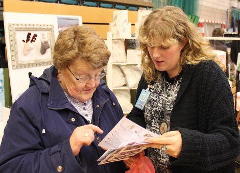 Designer Julie Williamson with a customer.