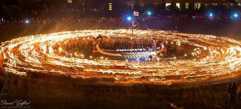 Dave Gifford's classic photo of the culmination of Tuesday's procession in Lerwick as a thousand guizers prepare to cast their burning torches into the galley.