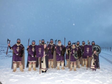 The bulk of the Cullivoe jarl squad line up on a snowy night.