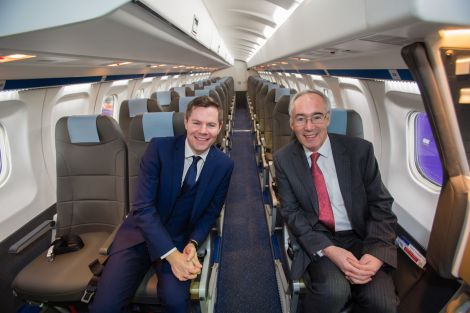 Transport minister Derek Mackay joins Loganair chairman David harrison in the newly refurbished Saab 340 - Photos: Loganair