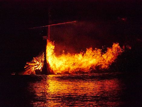 The galley burns on the sea off Peerie Spiggie beach. Photo Chris Brown