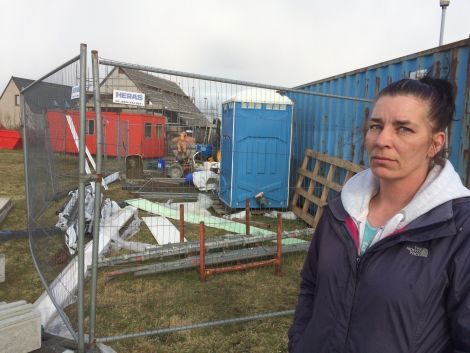 Mandie Fulbirg outside the building site surrounding her house on Stucco in Hillswick. Photo Shetnews