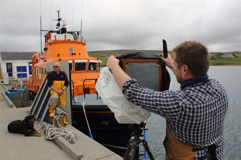 Jack Lowe preparing to capture Aith lifeboat coxswain Hylton Henry on glass.