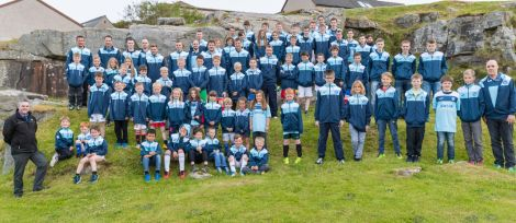 Players and coaches from Lerwick Thistle FC gathered with their new merchandise at Gilbertson Park on Tuesday night.