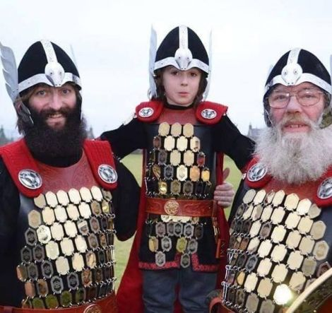 Lerwick guizer jarl for 2032 Gary Smith with his son Jackson and dad Willie.