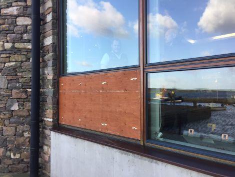A boarded-up window at the Shetland Museum following last week's break-in. Photo: Hans J Marter/Shetnews