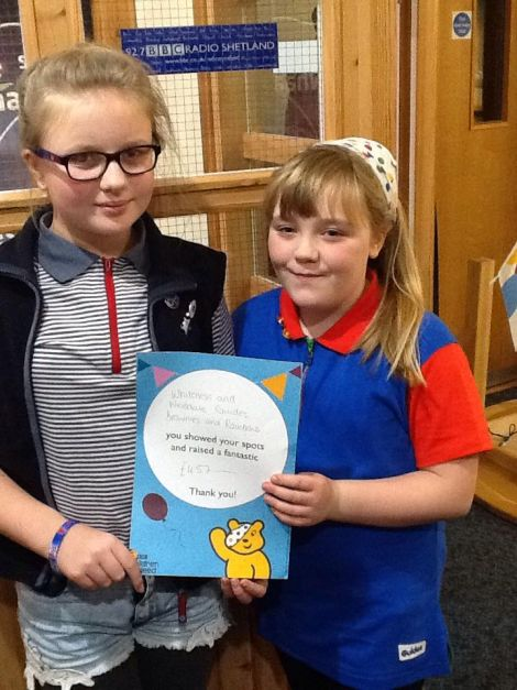 Rhiannon and Millie from the Whiteness and Weisdale Rainbows, Brownies and Guides, who raised £457 by hosting a coffee morning. Photo: BBC Radio Shetland.