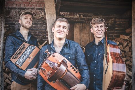 Dhoore are three brothers from Flanders whose energetic sound blends traditional Flemish folk music with their own style.