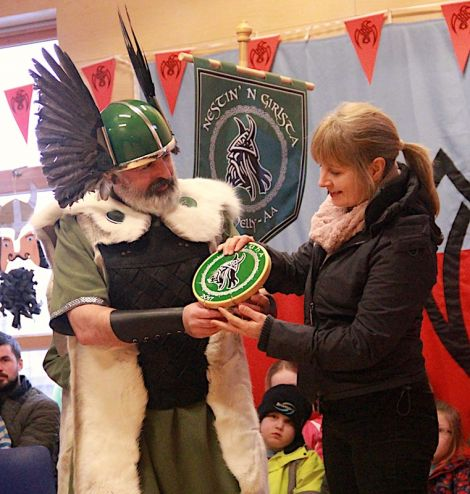 Teacher Vaila Stevenson accepts this year's Nesting & Girlsta Up helly Aa plaque on behalf of the school.