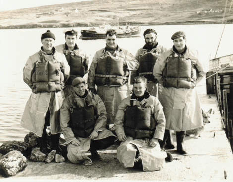 The Aith lifeboat crew in 1967. Back row (left to right): John Robert Nicolson (Coxswain), Frank Johnston (Mechanic), Kenny Henry (Crew), Michael Jamieson (Crew), Andy Smith (Bowman). Front row (left to right): Bill Anderson (Crew), Wilbert Clark (Assistant Mechanic) - Photo: Dennis Coutts
