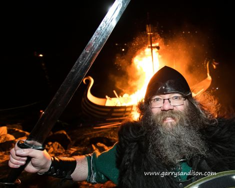 Cullivoe Up Helly Aa guizer jarl Mark Lawson thoroughly enjoying himself at the burning on Friday night - Photo: Garry Sandison