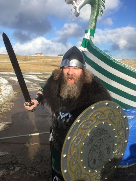 Here are the first photos from Cullievoe Up Helly Aa. Mid Yell junior high school head teacher Mark Lawson enjoying his time as guizer jarl - Photo: Garry Sandison