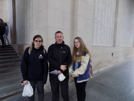 AHS S3 pupils Holly Mouat and Carys Nield pictured with history teacher John Sandison at Menin Gate, Ypres during last month's trip.