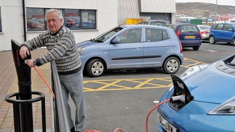 Jim Dickson recharging his Nissan Leaf in Lerwick, in March 2013. Photo: Hans J Marter/ Shetland News