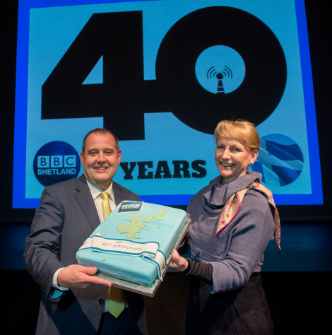 BBC Radio Shetland senior producer John Johnston and BBC Scotland director Donalda Mackinnon with the birthday cake. Photo: Malcolm Younger/Millgaet Media