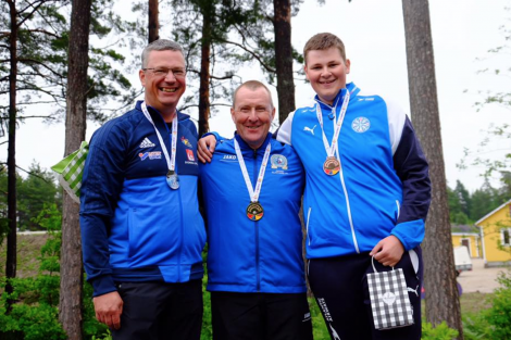 John Magnus Laurenson (centre) with his shooting peers after winning gold in the Olympic skeet individual event. Photo: Shetland Island Games Association