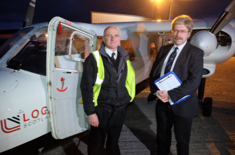 SIC returning officer Jan Riise (right) at Sumburgh Airport on Friday morning as a chartered plane was loaded with Shetland's ballot boxes. Photo: Shetland Islands Council