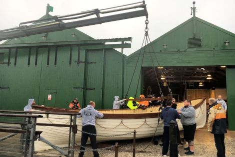Members of Shetland's weight training club helped move the restored Oceanic lifeboat - Photos: Shetland Amenity Trust