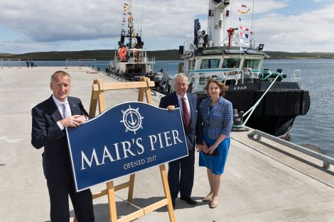 Mair's Pier was officially opened by Shetland MSP Tavish Scott (left), pictured with soon-to-retire LPA chairman Brian Anderson and the authority's chief executive Sandra Laurenson. Photo: John Coutts.
