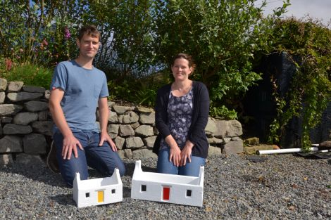 Luke and Kate Holt with two of their distinctive crofthouse planters in Quarff this week. Photo: Shetland News/Neil Riddell.