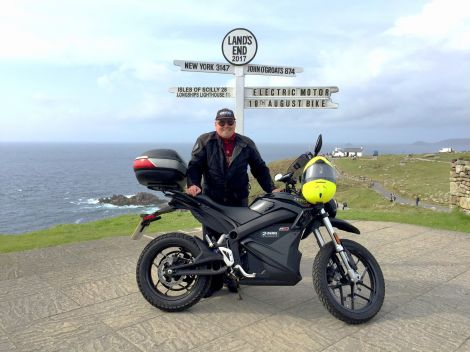 John Chivers at the Land's End sign at the start of his trip.