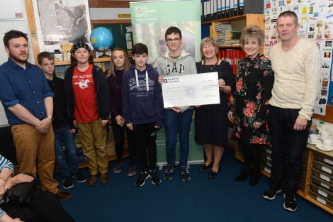 The winning team being handed a cheque from YPI. L-R: Kris Johnson, Luke Dutch, Alex Jamieson, Zoe Rivett, Kamran Irvani, Dougie Smith, Moira Bell, Helen Budgen, and Andy Paterson. Photo: Dave Donaldson