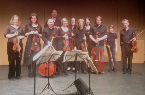 The Edinburgh Quartet (Tijmen Huisingh, violin, at rear; Tom Hankey, violin, far right; Catharine Marwood, viola, 5th from left; Mark Bailey, cello, 3rd from left) with members of Shetland Community Orchestra, after their stunning performance at Mareel. Photo: James Mackenzie