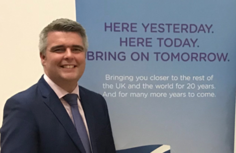 Flybe's Ronnie Matheson behind his company's tag line, which did not quite come to pass. Photo: Shetland News