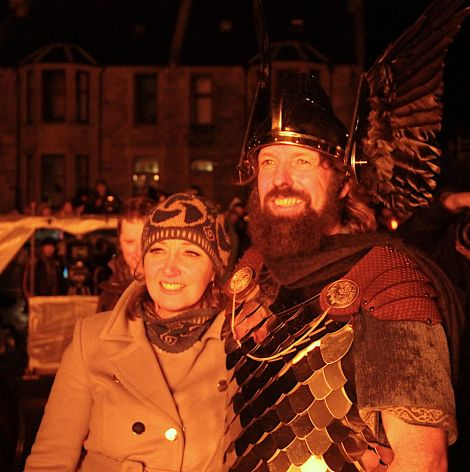 Jarl Stewart Jamieson and his wife Elaine watching the galley going up in flames.