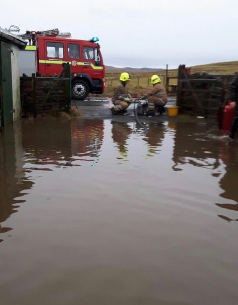 A fire engine was called out to pump water from the workshop and yard.