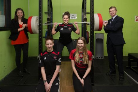 Scottish sports minister Aileen Campbell (left) was in Shetland earlier this month to launch the scheme. She is pictured here with council convener Malcolm Bell and members of the Lerwick Swim Team Adam Miller, Lauren Sandison and Kayla Manson. Photo: SIC