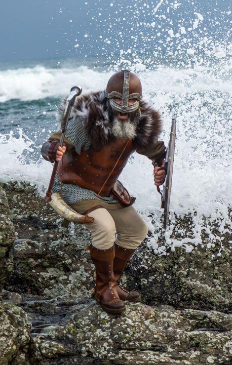 Warrior. The sea crashes behind a viking from Up Helly Aa 2017.