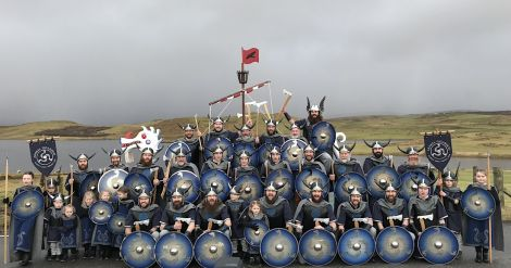 The jarl squad gathers for the traditional squad and galley photo outside Nesting school on Friday morning. Photo: Hans J Marter/Shetland News