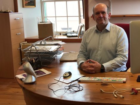 New Shetland Amenity Trust chief executive Mat Roberts at his desk in the trust's Garthspool offices. Photo: Shetland News.