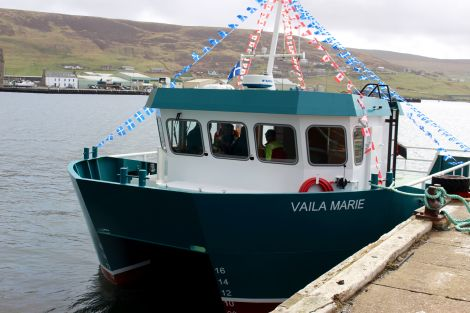 The Vaila Marie sporting Canadian flags in honour of Cooke Aquaculture's roots. Photos: Chris Cope/Shetland News