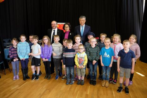 Primary pupils from Mid Yell JHS entertaining invited guests with a traditional Shetland song – Farewell to Yell. They are pictured with head teacher Mark Lawson (left), ambassador Liu Xiaoming and his wife Hu Pinghua. Photo: SIC