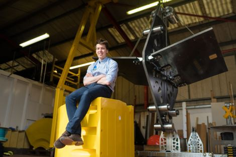 Aqua Power Technologies' Sam Etherington alongside a MANTA converter.