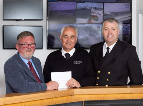 Left to right: LPA chairman Ronnie Gair, John McMeechan and Capt. Calum Grains, deputy chief executive and harbourmaster. Photo: John Coutts