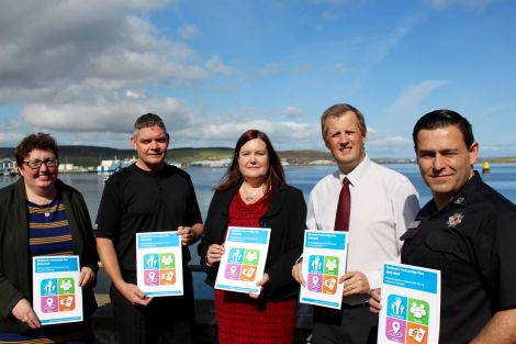 Left to right: HIE Shetland manager Rachel Hunter, chief inspector Lindsay Tulloch, SIC chief executive Maggie Sandison, NHS Shetland chief executive Ralph Roberts and fire service area manager Iain Macleod. Photo: Chris Cope