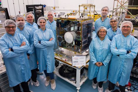 Brian Stewart (back right) with his Surrey Space Centre colleagues with the project's main satellite.