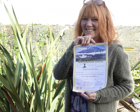 Anita Georgeson with her certificate proofing that she did it. Photo: Peter Johnson/Shetland News